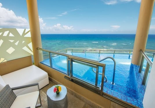 5* gourmet-inclusive adults-only Riviera Maya beach escape with oceanfront swim-up suite options